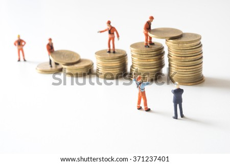 Wealth management, Businessman and construction site manager looking at team making gold coin step stair. - stock photo