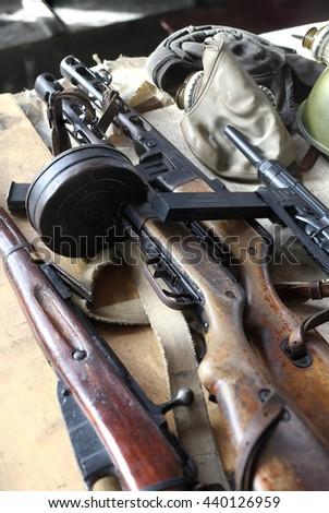 Weapon of times of World War II - Assault rifle, submachine gun, rifle, gas mask, flight helmet. - stock photo