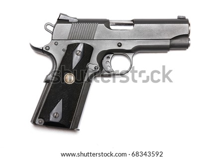 "Weapon series. 1911-family handgun with 4.3"" barrel. Isolated on a white background. Left side view. Studio shot."