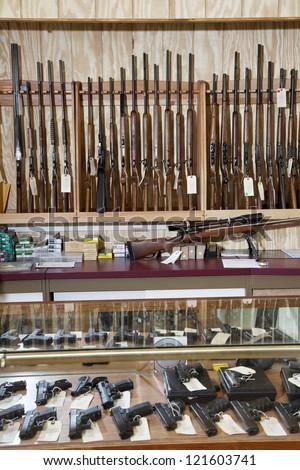 Weapons displayed in gun shop - stock photo