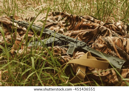 weapons lying on the ground - stock photo