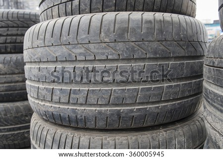 wear tires stacked up - stock photo
