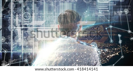wear view of businessman looking across window against image of a earth - stock photo