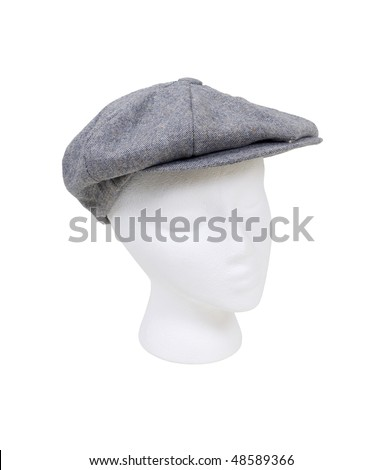 Wearing a masculine tweed flat driving cap worn on the head when out for a drive - path included - stock photo