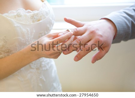Wearing a wedding ring to man finger - stock photo