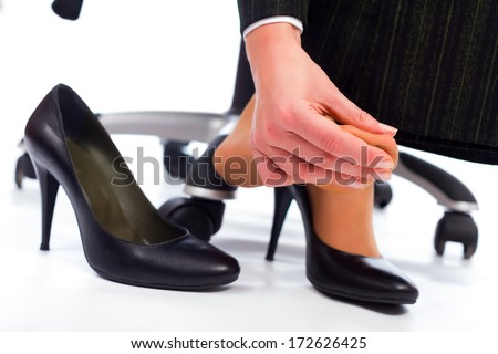 Wearing high heel shoes has its painful disadvantages - hurting feet, sole. - stock photo