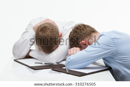 Weary businessmen sitting at the table, white background - stock photo