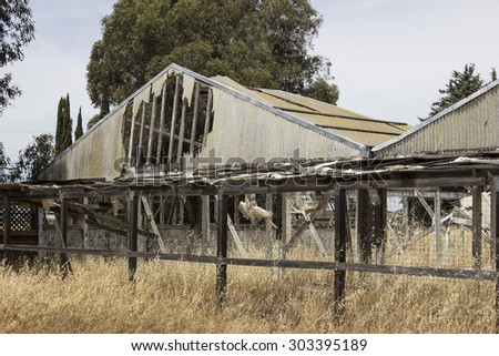 Weather damage to old hotel or commercial real estate.  Deserted, depressing and abandoned property. - stock photo