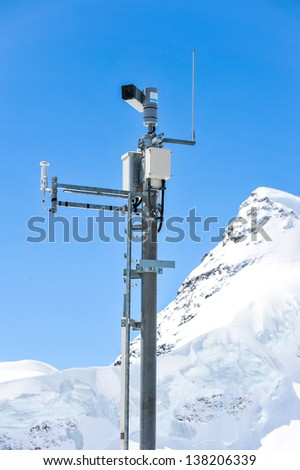 Weather Measurement Instrument with snow mountain in background - stock photo