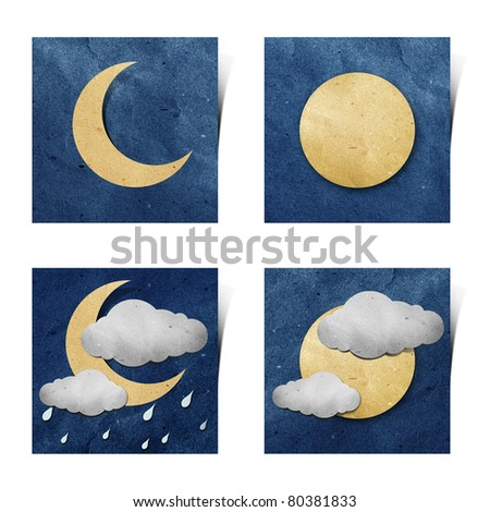 Weather recycled paper craft stick on grunge paper background - stock photo