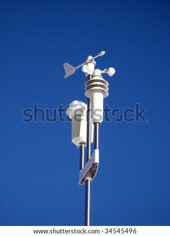 Weather station against blue sky - stock photo