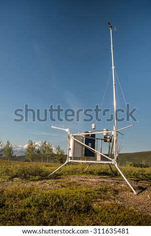 weather station at wonder lake ranger station in denali national park, with mt. denali visible in background - stock photo