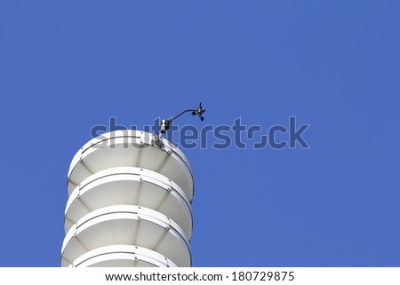 Weather station with anemometer, against blue sky - stock photo