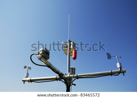 Weather station with various measurment devices - stock photo