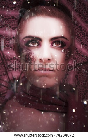 Weather The Storm Is The Face Of A Woman Standing In The Rain Looking To The Distance With An Intense Gaze Showing Determination Willpower And Inner Strength - stock photo