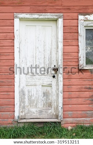 Weatherbeaten Door and Window of an Old Abandoned House - stock photo