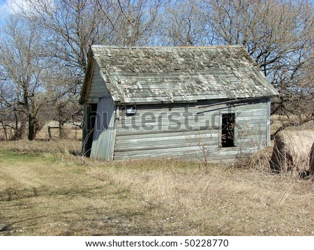 weathered abandoned farm building