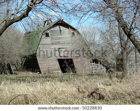 weathered abandoned farm building barn