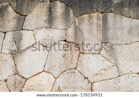 Weathered ancient greek stone wall cladding detail. - stock photo