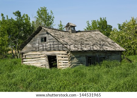 Weathered and abandoned log house
