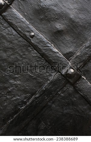 Weathered and rusty decoration element of vintage metal doors  - stock photo