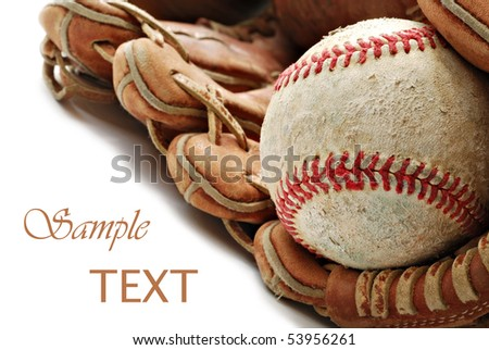 Weathered baseball in old leather glove on white background with copy space.  Macro with shallow dof.