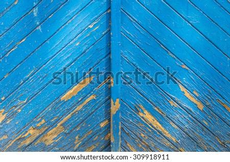 Weathered blue wooden door - stock photo