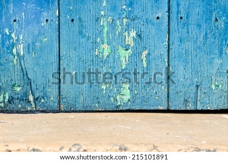 Weathered blue wooden panel - stock photo