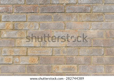 Weathered brick wall detail and closeup - stock photo