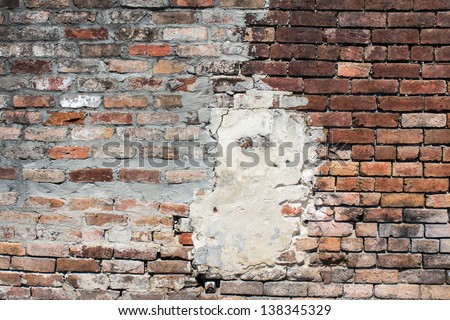 Weathered brick wall in New Orleans St Louis Cemetery #1. - stock photo