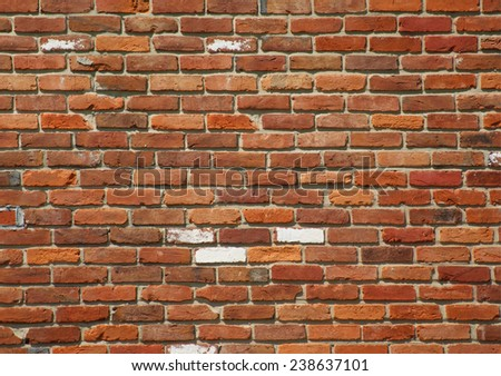 Weathered bright wall showing signs of age. - stock photo