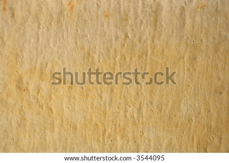 Weathered brown sandstone surface texture