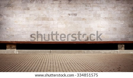 Weathered cinder block, brick wall texture with sidewalk. - stock photo