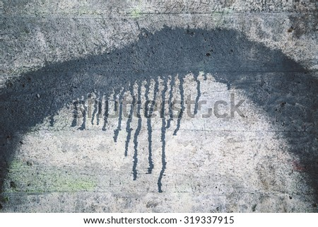 Weathered concrete wall texture and black paint dripping - stock photo