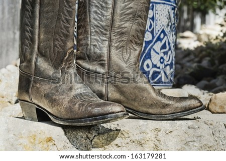 Weathered cowboy boots - stock photo