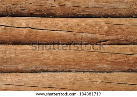 Weathered cracked wooden logs with natural pattern retro background - stock photo