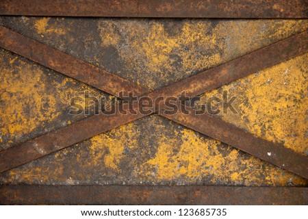 weathered cross steel on yellow iron door - stock photo