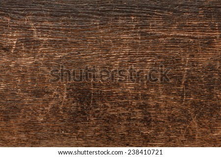 Weathered Dark Wood with Cracks and Scratches - stock photo