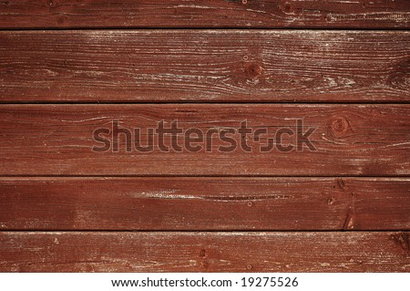 Weathered deep-brown painted plank close-up - stock photo
