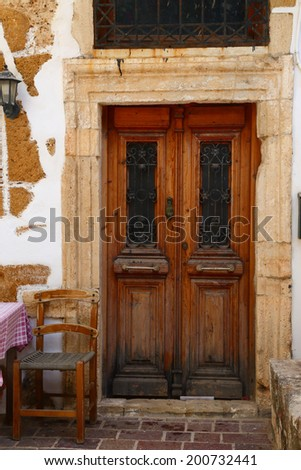 Weathered door on the old town of Chania, Crete island - stock photo