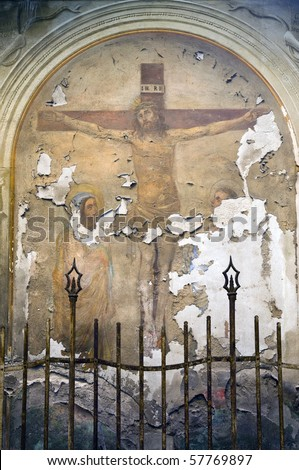 weathered fresco in Lucca, Italy depicting Jesus' crucifixion