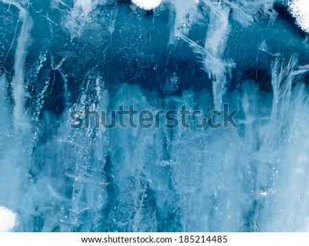 Weathered frozen water ice surface candelized with cracks and air bubbles nature background texture pattern - stock photo