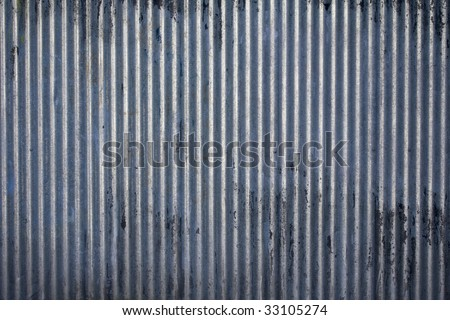 Weathered galvanized and corrugated sheet steel texture - stock photo