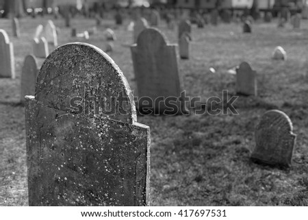 weathered gravestones in a historic cemetery - stock photo