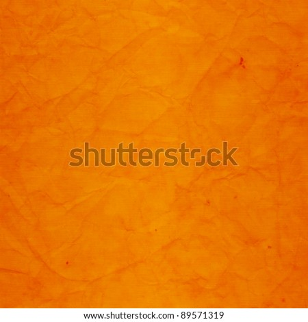 Weathered, grungy, marbled wall in shades of orange - stock photo
