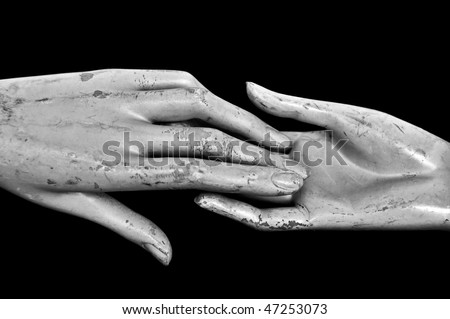 Weathered hands of plastic mannequin doll. Black and white.