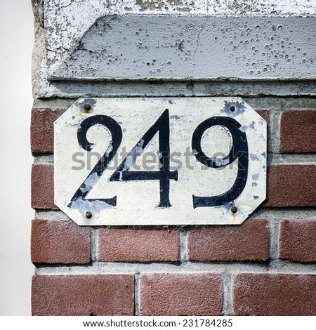 Weathered house number two hundred and forty nine. - stock photo