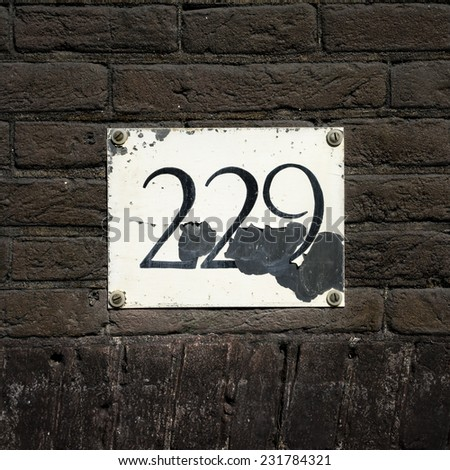 Weathered house number two hundred and twenty nine - stock photo