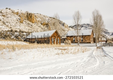 Weathered houses in the Montana ghost town of Bannack State Park in winter - stock photo