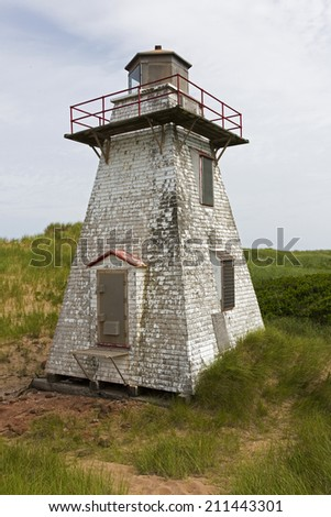 Weathered Lighthouse at Prince Edward Island National Park Greenwich - stock photo